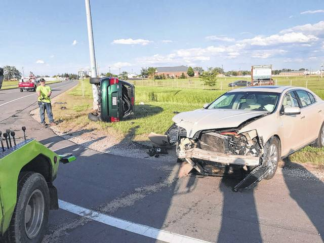 Crews clean up a two-vehicle accident on U.S. Route 22 near the Sears Hometown Store on Wednesday. One man was flown by MedFlight to Grant Medical Center in Columbus.