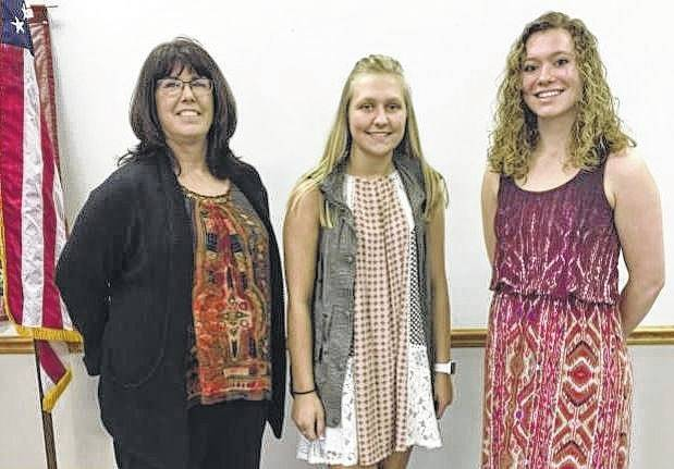 Brenda Riley (left), AAUW scholarship committee chair, awarded scholarships to two exceptional young women from Miami Trace High School: Ceairra Puckett (center) and Clare Sollars (right).