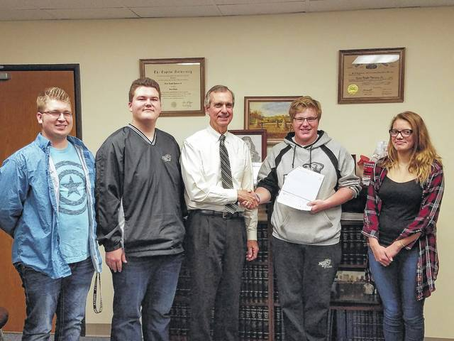 Miami Trace students pictured with the judge are Quinton Waits, Dylan Page, Ely Schirtzinger and Destiny Schook.