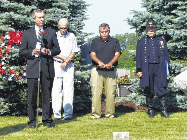 Washington Municipal Court Judge Vic Pontious recites the Gettysburg Address as other speakers at the Bloomingburg Memorial Day service look on: (left to right) Bill Cupp, Wayne King, and Robert E. Grim.