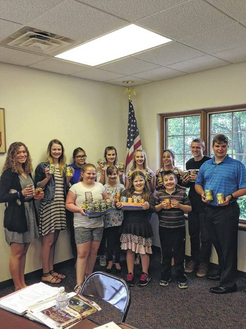 Pictured are members of the Charm-N-Farm 4-H Club with their canned food donations for the Fayette County Food Pantry.