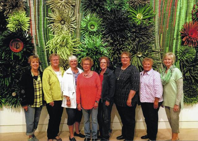 The Deer Creek Daisies Garden Club is pictured above at the Springfield Museum of Art. From left to right, Rita Lanman, Judy Gentry, Julie Schwartz, Connie Lindsey, Jeanne Miller, Joyce Schlichter, Kendra Knecht and Emily King. They are pictured in front of Industrial Nature titled Spring Millet, a 30' X8' X18' garden hose exhibit, miscellaneous glass, metal and plastic, approximately 100 units.
