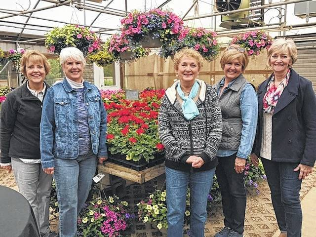 The Deer Creek Daisies recently visited the Rhoads Farm in Circleville. From left to right, Rita Lanman, Julie Schwartz, Marty Cook, Billie Lanman and Emily King.