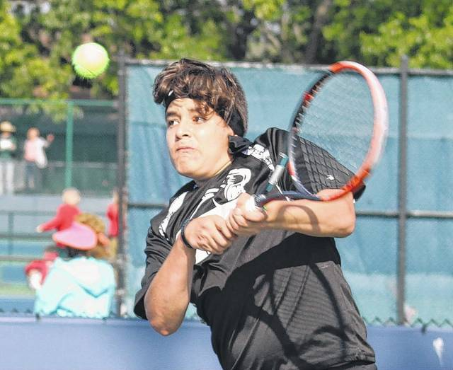 Juan Diego Navas, a senior at Miami Trace High School, hits a return during a Division II singles match at the State tournament in Mason Friday, May 26, 2017.
