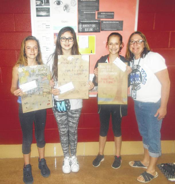 The top three winners in the Fayette Soil & Water Conservation District poster contest were recently announced. From left to right, Kayli Merrit, Madison Hayes and Audrey Lotz, pictured with art teacher, Mrs. Rose.