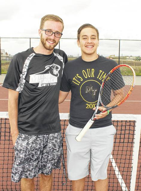 Miami Trace head tennis coach Mitch Augenstein, left, with State-qualifier Juan Diego Navas prior to practice Wednesday, May 24, 2017.
