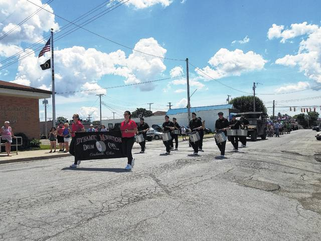 Dynamic Mention Drum Corps from Circleville joined the New Holland Memorial Day festivities during the village's annual parade Monday.