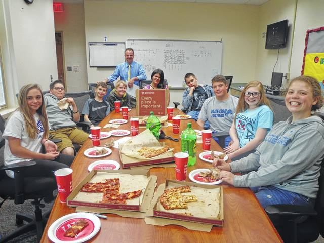 "Donatos recently provided pizza to these students at Washington Middle School as they celebrated ""Pizza with the Principals."" This is in appreciation for their selection as Students of the Month for May. They are chosen by their teachers because of the outstanding example they set for their peers in such areas as academic effort, good work ethic, kindness to others, and service to their school. Pictured from left: Cheyenne Tuttle, Caden Hott, Conner Bivens, Draven Shadley, Mr. Montgomery/Assistant Principal, Mackenzie Tyler, Kenton Cropper, Sterling Smith, Jenna Hesson and Julianne Bailey. Absent from picture: Jacob Guisinger."