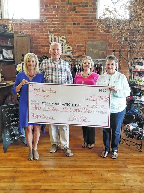 Fayette County Memorial Hospital (FCMH) Foundation recently received a check in the amount of $409 from Barb Saville, owner of Sweetwater Bay Boutique. Pictured (L to R): Barb Saville owner of Sweetwater Bay Boutique, Roger Kirkpatrick FCMH Foundation Vice President, Chelsie Hornsby FCMH Director of Business Development, and Norma Kirby FCMH Foundation Secretary.