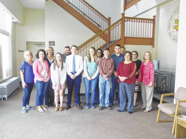 The Fayette County Chamber of Commerce recently awarded five scholarships to graduating seniors. Recipients were welcomed at a recent Chamber board meeting. From left: (front row) board members Merleen Van Dyke and Kate Dolphin, Washington High School students Gretchen Milstead and Ethan Marting, Fayette Christian School senior Elizabeth Garren, and Miami Trace seniors Nicholas Elrich and Cole Karnes, Whitney Gentry, Chamber President. Back row: Chamber board members Holly Cottrill, Branen Weade, Karen Cassidy, John Hedges, Vanessa Blevins and Kim Oesterle.