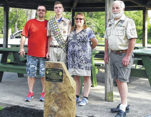 From left to right, John Downing, Jacob Downing, Tracy Downing, and Scoutmaster Glenn Rankin.