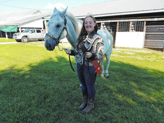 "Taylor Perkins was crowned on Tuesday evening to serve as the 2017 Fayette County Horse Queen for the fair. She is pictured with her horse, ""Dusty."""