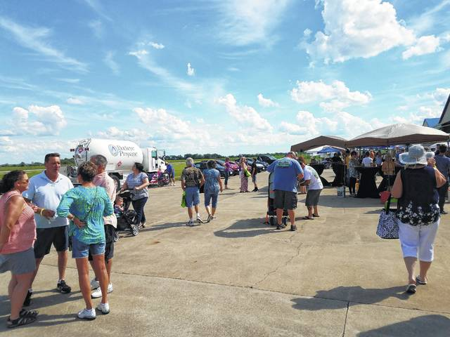 The third-annual Fayette County Toast to Summer and Hot Air Balloon Glow was held Saturday at the airport with a large crowd turning out to enjoy wonderful weather and a large variety of vendors, wineries and entertainment.