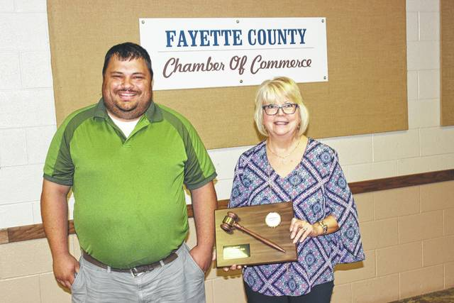 Chamber board chair for the past year, Merleen Van Dyke, passed the gavel to the new chair, Branen Weade at Wednesday's luncheon.