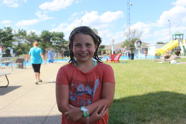 "Aubrey Kinzer, age 8, learned to officially swim at the Jeffersonville Community Pool last summer. ""It's fun. It's like the only time you get to get wet and play games,"" said Kinzer."