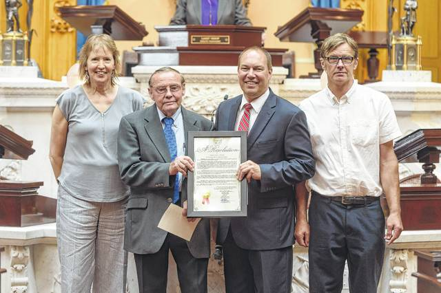 Ohio Sen. Bob Peterson (second from right) presented state dairy producers with a resolution Wednesday to commemorate the month of June as National Dairy Month.