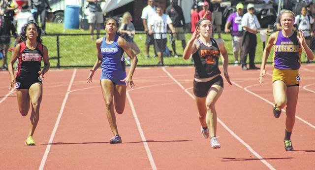 Washington High School freshman Rayana Burns (second from left), runs in a heat of the 200-meter dash at the Division II State track meet Friday, June 2, 2017 at The Ohio State University in Columbus. Burns became the first female athlete to qualify to the State meet in four events in school history. At right is Chayden Pitzer of McClain. Flanking Burns, at left, is Lauren Carter of Bellefontaine and between Burns and Pitzer is Abby Davis of Richwood North Union. Please see today's sports for a report.