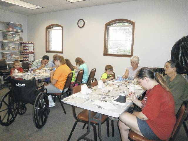 Jeffersonville Branch Library was the place to be to paint a ceramic shoe for that special Dad in your life. Many gathered to do just that, from left to right are Landon, Nate, Holly, Riley, Annabel, Lilly, Jaden with Grandma Anita, Jessica and Jean.