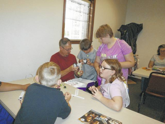 Aaron Teter, children's specialist from Carnegie Public Library, recently taught a STEAM (Science, Technology, Engineering, Art and Mathematics) program at Jeffersonville Branch Library using Little Bits. This program was a hit.