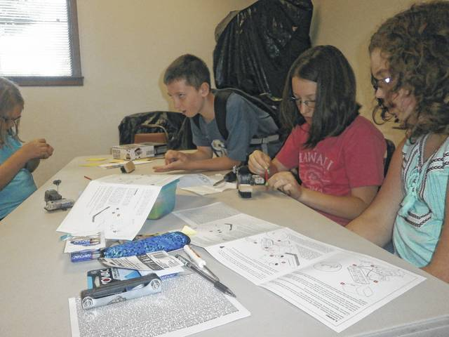 Jeffersonville Branch Library was the place to be for Miss Susan's STEM program: creating a Brush Robot. Those attending enjoyed working together to create a Brush Robot from a kit donated by Phyllis Fannin. Those enjoying the program were Seth, Abby, Zoee, Lilly, Holly and Riley.
