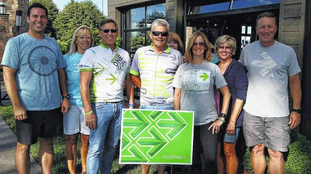 Local Pelotonia committee members shown are Matt Pettit, Linda Hansen, Milan Hansen, David DaRif, Leslie DaRif, Angie Curtis, Cheryl Fisher and Mark Fisher. Not shown are committee members Jane and Don Pope, Susan Eckles and Kelli Chambers.