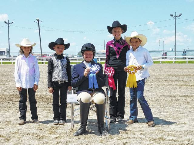 The 2017 Fayette County Junior Fair Versatility Horse Show was held on Tuesday morning with roughly a dozen participants. In the beginner class, Mary Gerber took first place (seated), Garren Walker took second place (second from right) and Lucas King took third (at right). Other participants were Alora Self and Chloe Gardner. The sponsor for this class Michael and Angela DuVernay and Family.
