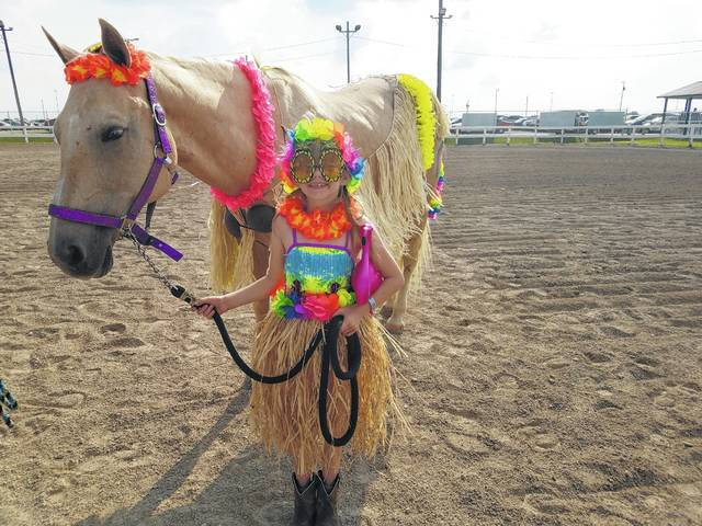 The 2017 Fayette County Junior Fair Horse Costume Contest was held Wednesday evening. Shelby Snider and her horse Lilly dressed as hoola girls.