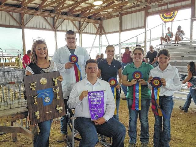On Saturday, Dylan Page (seated) was named the 2017 Fayette County Junior Fair Small Animal Division Showman of Showmen. He is pictured with (L to R): Fayette County Fair Queen Marissa Sheets, fifth place winner Corben Hastings, third place winner Tori Evans, second place winner Aubrey Schwartz and fourth place winner Addyson Butts.