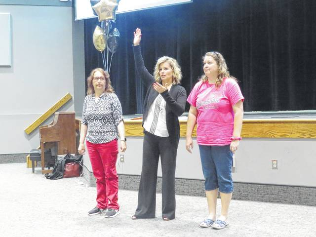 Area educators join LaVonna Roth in demonstrating how the brain fires and makes connections in the learning process.