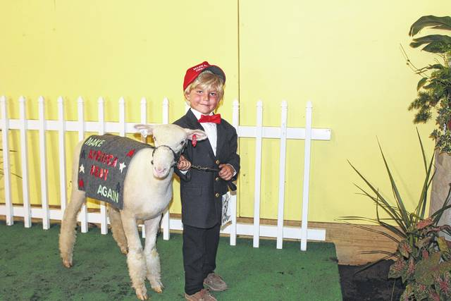 Clint Wilt, winner of the Costume Class on Monday at the Fayette County Guys & Gals Sheep Lead, delighted the crowd at the Fayette County Fair Sales Arena with his Donald Trump costume. The award is sponsored by Hartley Oil Company.
