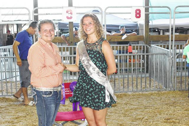 Kasi Payton (left) became the top showman Tuesday at the Fayette County Junior Fair Swine Showmanship competition. She is pictured with Fayette County Fair Attendant Clare Sollars.