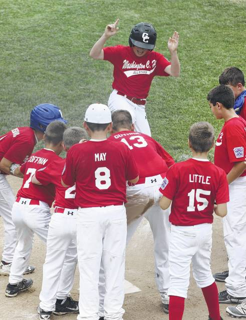 Washington C.H. all-stars gather around home plate as Braydon Kettles scores following a home run during a District Eight semifinal game against Fairborn Saturday, July 1, 2017. Teammates pictured (l-r); Brady Armstrong, Mason Coffman, John Wall, Wesley May, Drew Guthrie, Cole Little, Bryson Sheets and Jonah Waters.