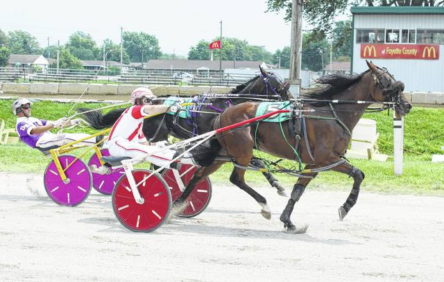 Mighty Rock (No. 5) driven by Ryan Holton, noses past Feelin American (driven by Dan Noble) to win the D.E. Mossbarger Fayette County Classic Saturday, July 22, 2017 at the Fayette County Fair.