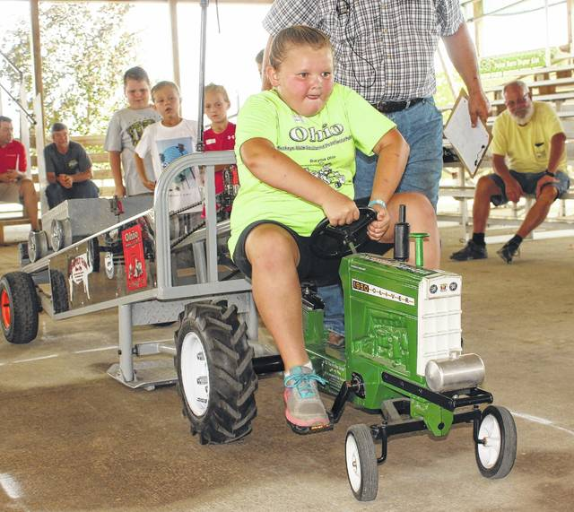 Molly Whiteside competes in the pedal pull at the Fayette County Fair Saturday, July 22, 2017. Molly won the 7-year-old division to qualify to State. See today's sports for more pedal pull photos.