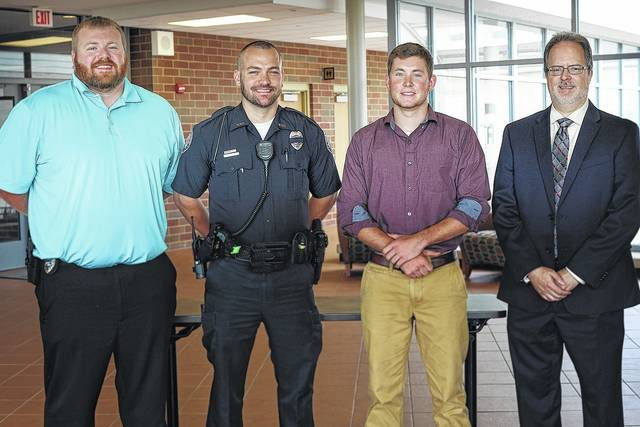 Attending the presentation of the City of Washington Court House Police Department Scholarship are (l-r) Detective Colt Sever, Patrolman Mike Warnecke, scholarship recipient Ethan Conn, and SSCC Dean of Technical Studies Jeff Montgomery.