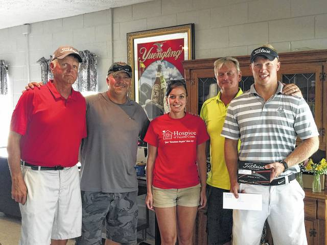 The Annual Hospice of Fayette County Golf Outing was held Saturday, July 8 at Buckeye Hills Golf Club. First Place went to Dusty Miller, Tom Schoettle, Craig Unger and Rick VanMatre. They are pictured with Carolyn Moore of Hospice of Fayette County.