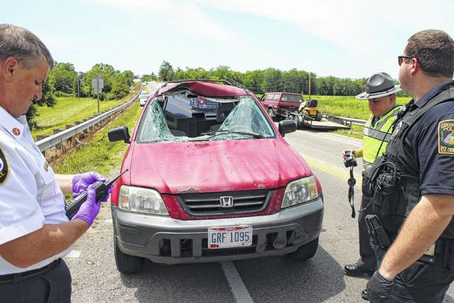 Shown is the car which was struck June 28 by a loose wheel that flew through the air and killed Jeffrey Calhoun, the father of Jeffrey Ryan Holsinger, the Greenfield man accused of two fatal shootings on July 4, the day after his father's funeral and cremation.