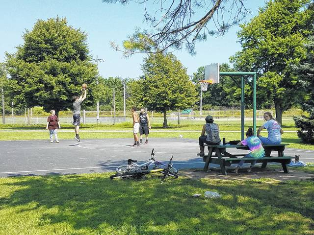 Several Fayette County residents visited Eyman Park on Wednesday to enjoy the weather and play some basketball. Other families could be seen playing on the jungle gyms, swings and other park equipment.