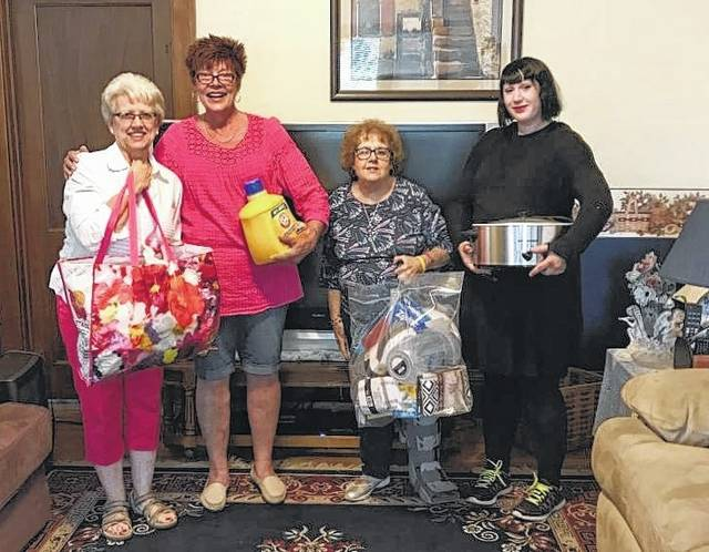 From left to right, Altrusa members: Jeannie Bihl, Teresa Persinger, and chair Teresa Combs with shelter volunteer Elizabeth. (Not pictured: Altrusa literacy members: Sonja Seiler, Nancy Bennett, Anne Quinn and Julie McDonald)