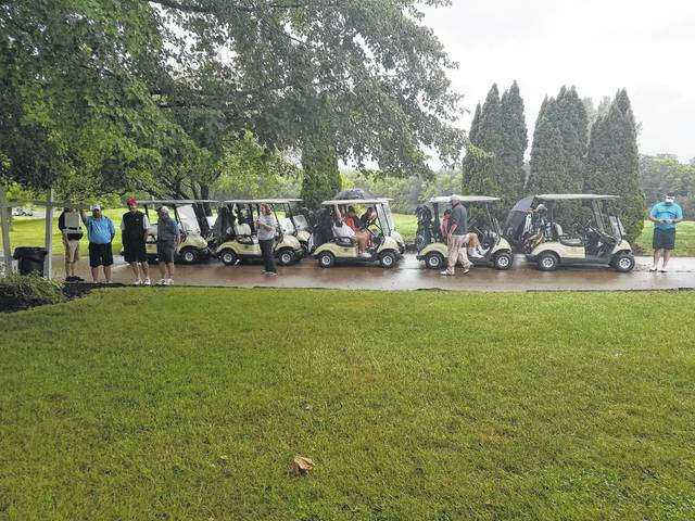 Golfers from the 2016 outing await the shotgun start. To register for this year's outing, call 740-335-0761.