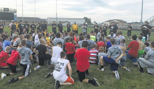 Miami Trace recently held a summer youth football camp for kids who will be in grades 3-8 this upcoming school year. High School head coach Jerry Williams, third from right, speaking to all of the youth participants, stressed the importance of being thankful to your parents.