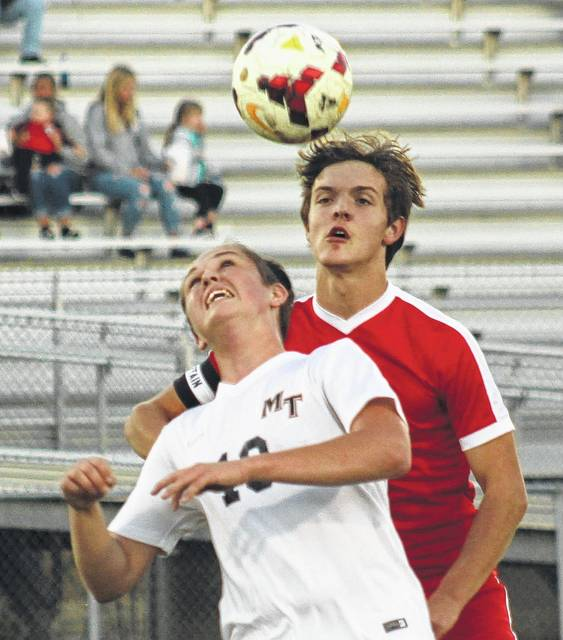 Miami Trace's August Langley battles a Hillsboro player for the ball during a Frontier Athletic Conference match at Miami Trace High School Thursday, Sept. 28, 2017.