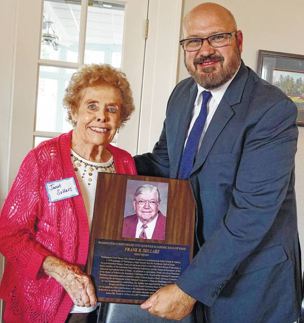 Janet Sollars, wife of the late Frank B. Sollars being posthumously inducted into the Washington City School Academic Hall of Fame, is pictured with Washington City School superintendent Tom Bailey with the plaque for Frank B. Sollars.