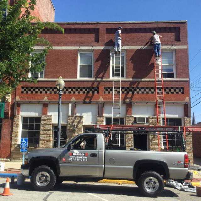 Work was underway Tuesday on the facade of this building owned by Steve Pond on South Main Street.
