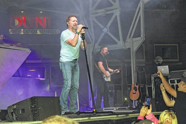 "Country music star Craig Morgan filled the streets of downtown Washington Court House with the sounds of his hit songs on Saturday evening on Main Street during the 2017 Scarecrow Festival. Some residents waited hours to get a perfect spot for the show as the street was filled from side to side with viewers of all ages. According to city officials, close to 5,000 people attended the annual festival over a three-day period. According to Mekia Rhoades, Main Street Committee president, the festival was bigger and better this year with more vendors, more food and great entertainment. Washington C.H. City Manager said the festival was ""extremely successful."""