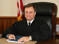 Judge Coss