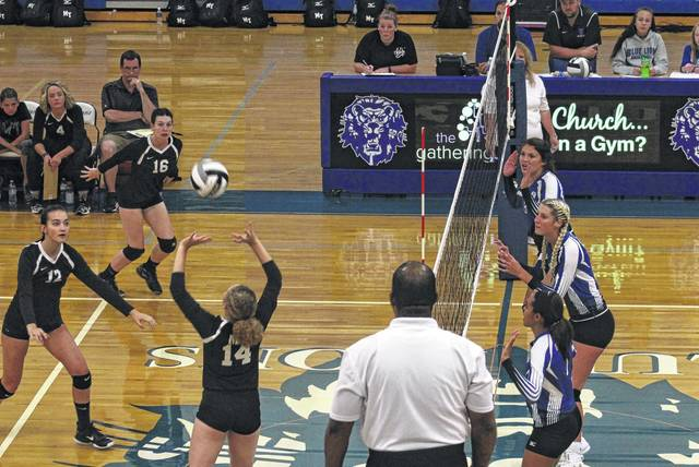 Miami Trace's Grace Bapst (14), at left, sets the ball for either Kate Leach (12) or Taylor Dawson (16) during a Frontier Athletic Conference match against Washington's front line of (left to right), Rayana Burns, Faith Kobel and Trinity Ragland at Washington High School Tuesday, Sept. 19, 2017.