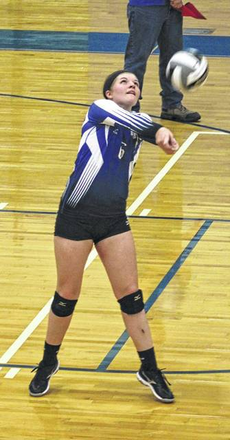 Washington's Maddy Jenkins passes the ball up from the back of the court during a Frontier Athletic Conference match against Jackson at Washington High School Tuesday, Sept. 12, 2017.
