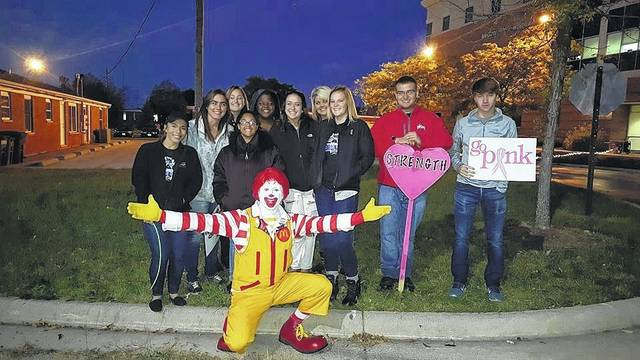Ronald McDonald and local students.