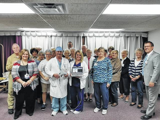 The Fayette County Memorial Hospital Auxiliary made a donation to the hospital during the auxiliary meeting Sept. 11th. A Picc Tip Line Machine was given to Dr. William Stevenson, Jane Wilson RN, Tammie Wilson CNO, Chelsie Hornsby business development director, and Mike Diener CEO. The gift was presented by Carolyn Reinwald, Harold Merritt, Barbara Black, Karen Whiteside, Carolyn Mallow, Sonja Seiler, Karma Breedlove, Pat Gall, Colleen Downing, Jody Hanawalt, Sharon Irons, Jeannie Rivers, Nancy Walters, Patsy Stevens, Roxy Holbrook, Suzanne Kidd, Billie Dugan, Jim Hamilton, Jean Ann Davis and Barbara Vance, volunteers at FCMH.